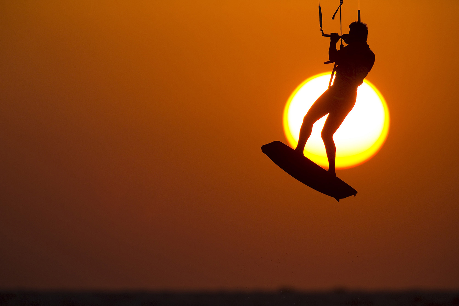 A man kitesurfs in the Mediterranean sea at the southern Israeli city of Ashkelon