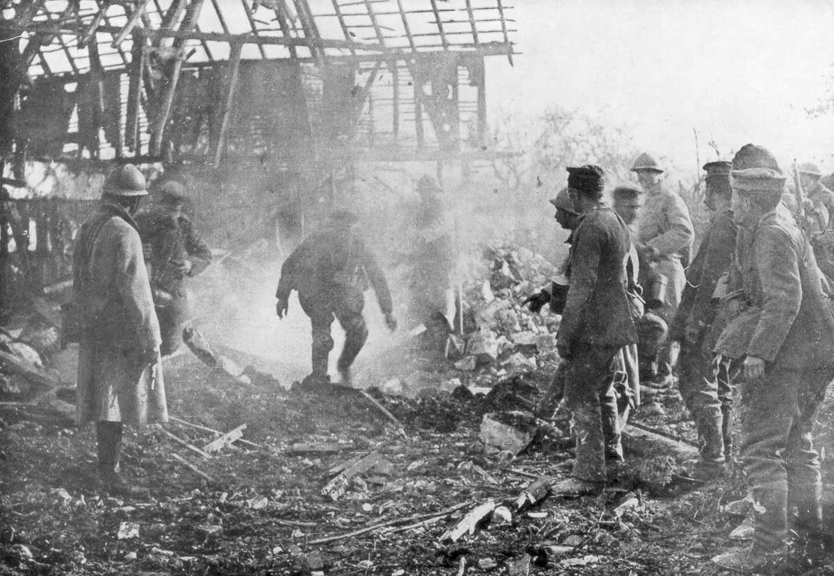 French troops using flamethrowers to flush out Germans from their shelters, Cantigny, France, 1918.