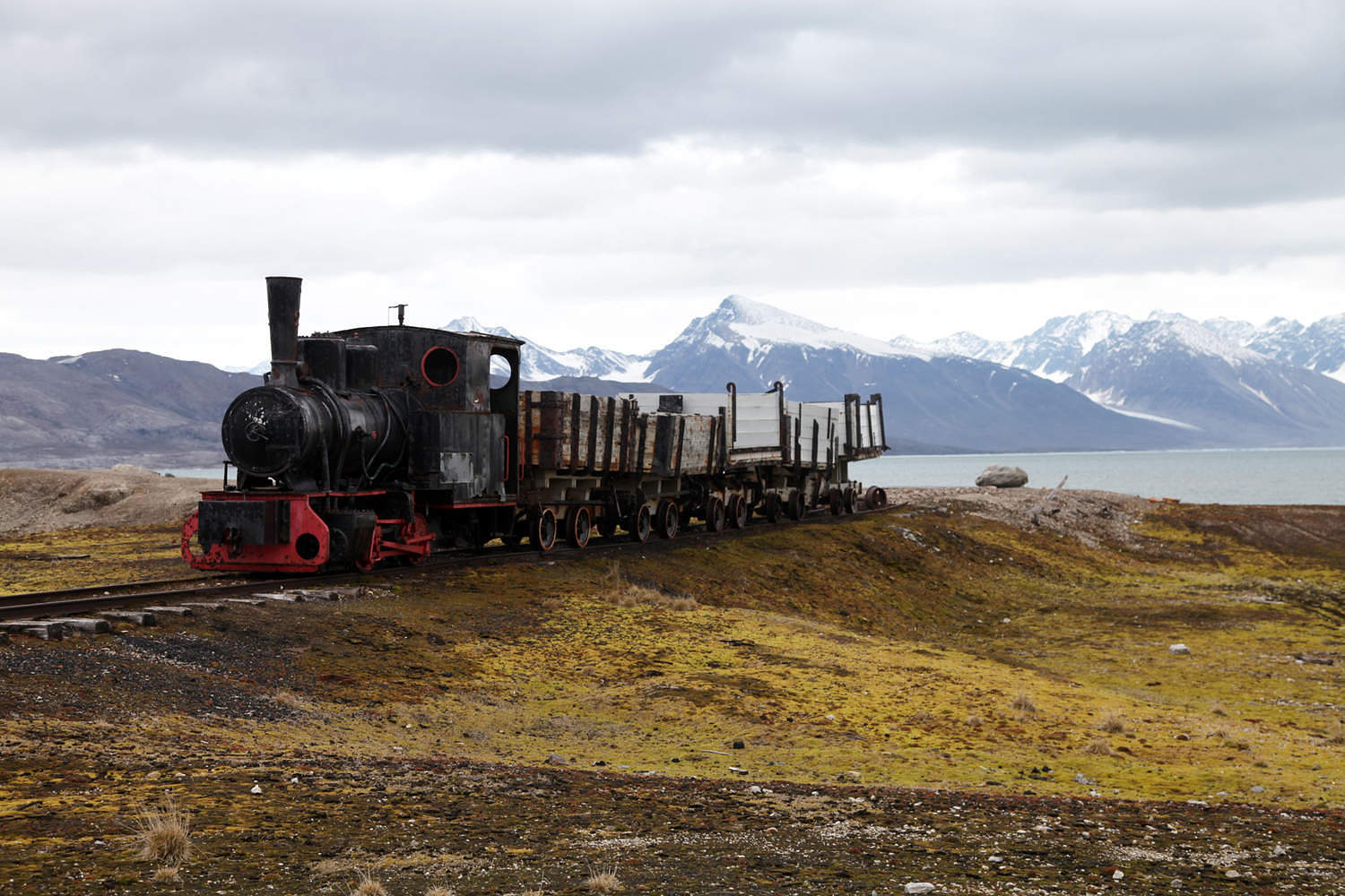 Coal trucks and locomotive preserved as a monument at Ny Alesund, Svalbard, Norway, Scandinavia, Europe