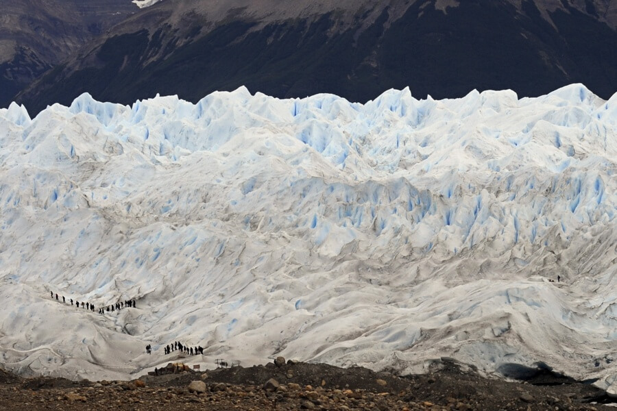 people-walking-on-glacier