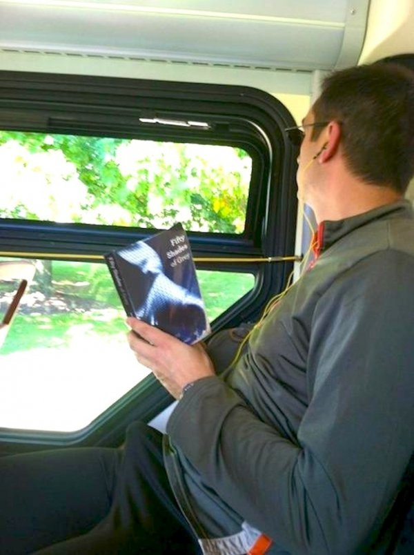 e0300ac00986a26d37320c953237c107-man-far-too-excited-reading-50-shades-of-grey-on-bus