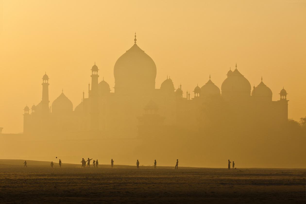 Boys playing soccer, Taj Mahal
