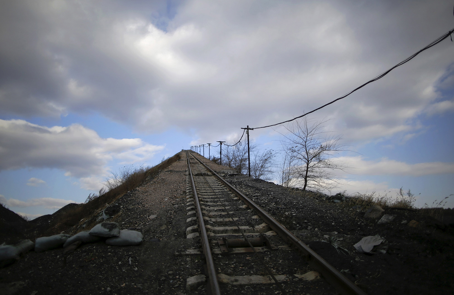 A railway track for carrying coal gangue, also known as coal waste, leads onto the top of the gangue hill from the exit of a coal mine on the outskirts of Jixi in China