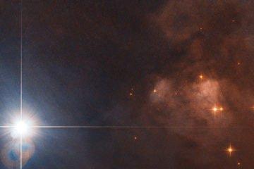 фото призрачно-голубых объектов в глубоком космосе